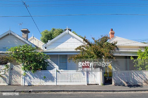 Charming bungalow homes with white picket fence. : Stock Photo