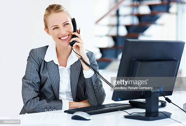 Charming business woman talking on phone