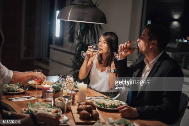 Charming couple drinking wine during dinner