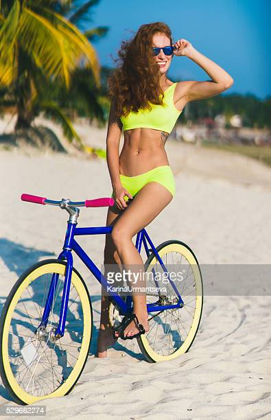 charming female with rental bike outdoors