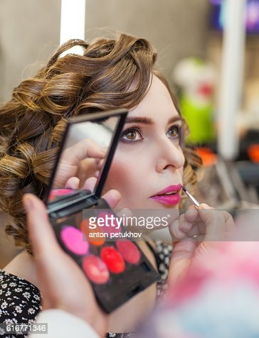 Charming Girl doing make-up in a beauty salon. : Stock Photo