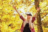 Charming girl playing with vitural reality simulator