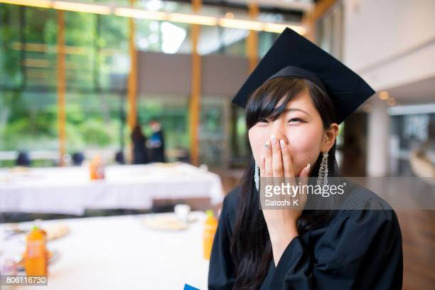 Charming graduate taking a bite before party