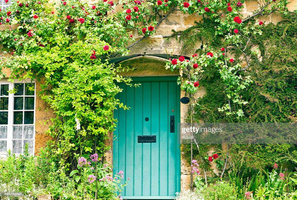 Charming House with green doors and red roses  Stock Photo & Charming House With Green Doors And Red Roses Stock Photo | Thinkstock
