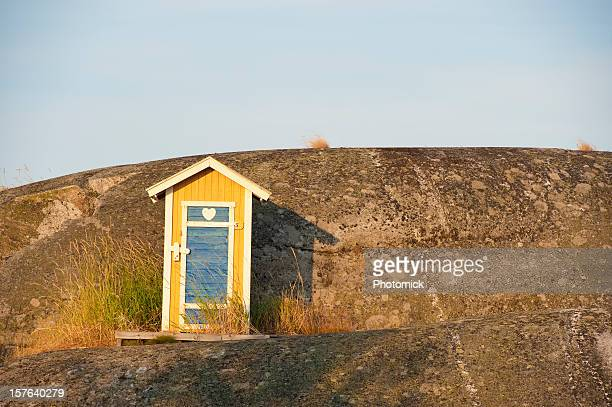 Charming little loo in the archipelago, warm evening light