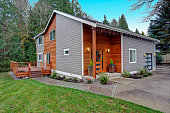 Charming newly renovated home exterior, natural wood siding and grey siding help to encrease curb appeal.