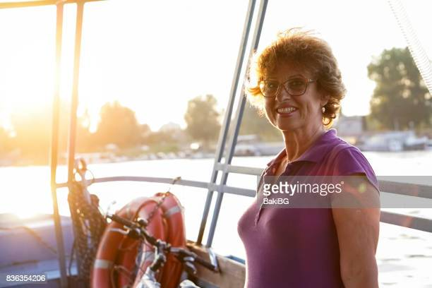 Charming senior woman on a boat