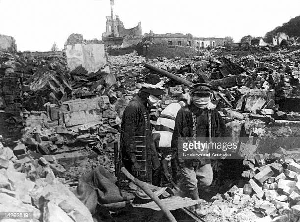 Charnel house employees wearing cloth masks searching the ruins from the 83 earhquake that hit here a few days ago Yokohama Japan September 4 1923...
