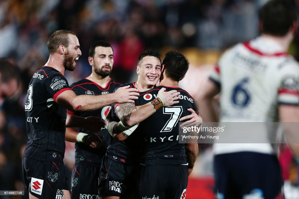 Charnze Nicoll-Klokstad of the Warriors celebrates with teammates Shaun Johnson, Simon Mannering and Ben Matulino after winning the round nine NRL match between the New Zealand Warriors and the Sydney Roosters at Mt Smart Stadium on April 30, 2017 in Auckland, New Zealand.