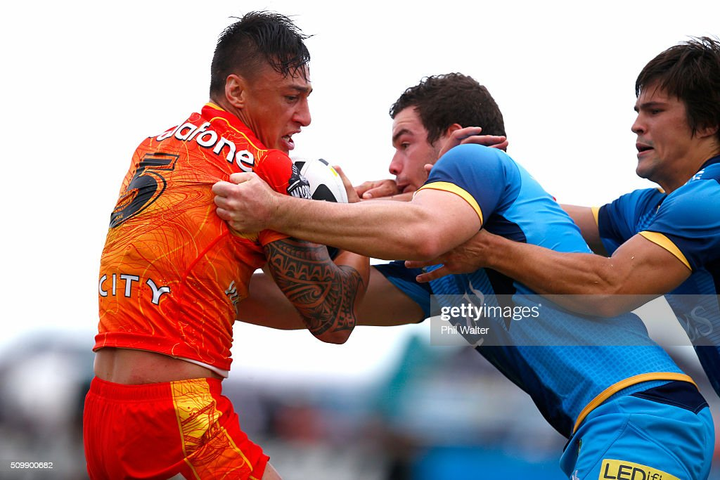 Charnze Nicoll-Klokstad of the Warriors is tackled during the NRL Trial Match between the New Zealand Warriors and the Gold Coast Titans at Toll Stadium on February 13, 2016 in Whangarei, New Zealand.