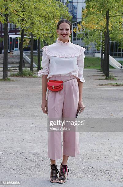 Charolette Calixte seen wearing MS top Asos pants Chloe purse YSL shoes during Paris Fashion Week Spring/Summer 2017 on September 30 2016 in Paris...