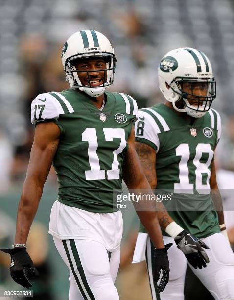 Charone Peake and ArDarius Stewart of the New York Jets warm up before a preseason game against the Tennessee Titans at MetLife Stadium on August 12...