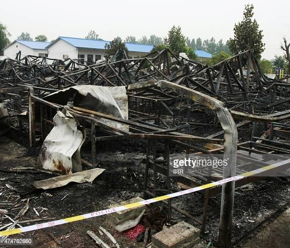Charred building frames and bedsteads are seen after a fire broke out in a nursing home in Luxian county in Pingdingshan central China's Henan...