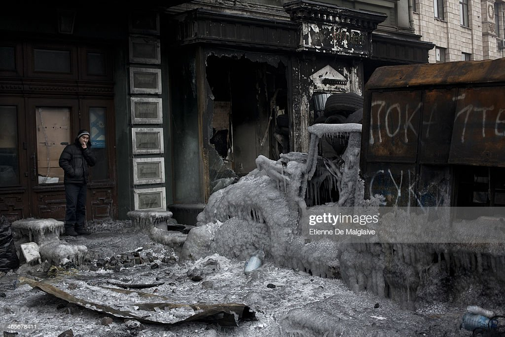 A charred police truck covered with ice has become part of the protester's barricade on January 28, 2014 in Kiev, Ukraine. While Ukrainian parliament holds an emergency session, standoff continues on Hrushevskoho street between anti-government protesters and riot police.