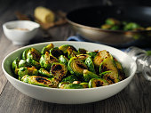 Home made freshness Charred sprouts with spicy herb butter and fine chopped hazelnuts