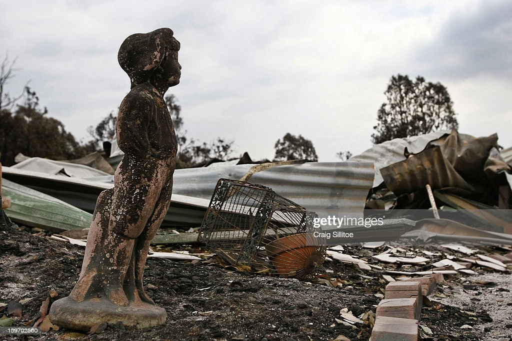 A charred statue sits among debris after a fire in the town of Seaton on January 19, 2013 in Melbourne, Australia. Bushfires in Victoria have claimed one life and destroyed several houses. Record heat continues to create extreme fire conditions throughout Australia.