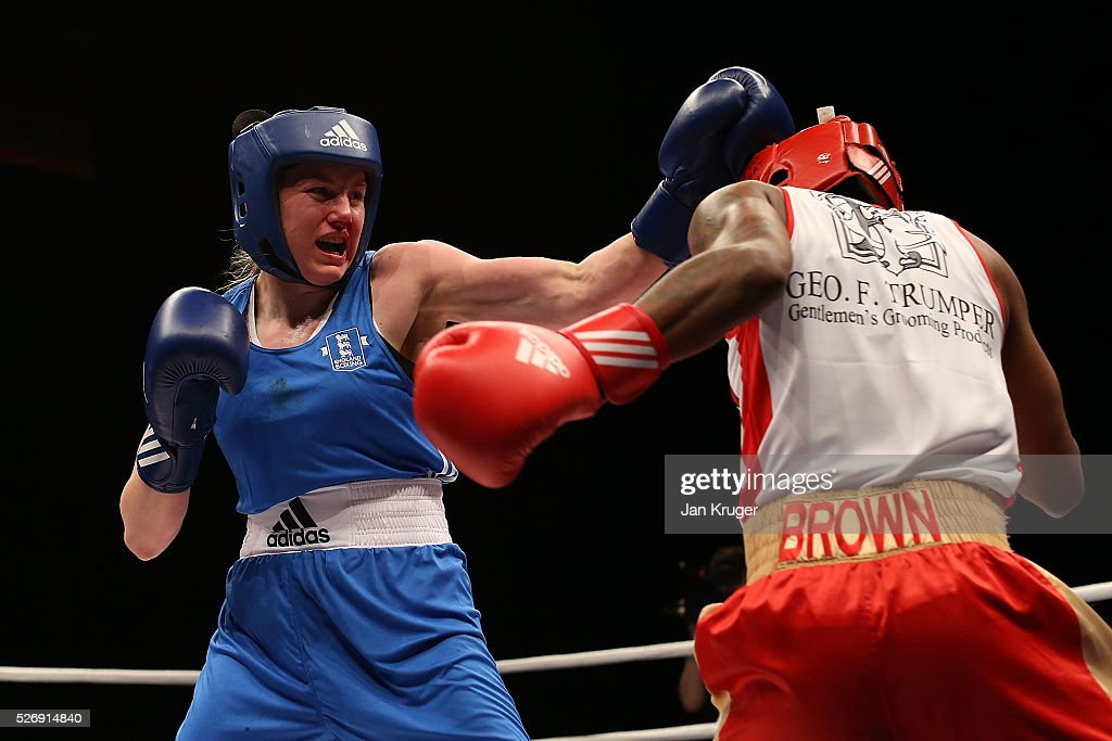 Charrelle Brown(red gloves) in action against Paige Murney in their over 64kg final bout during day three of the Boxing Elite National Championships at Echo Arena on May 01, 2016 in Liverpool, England.