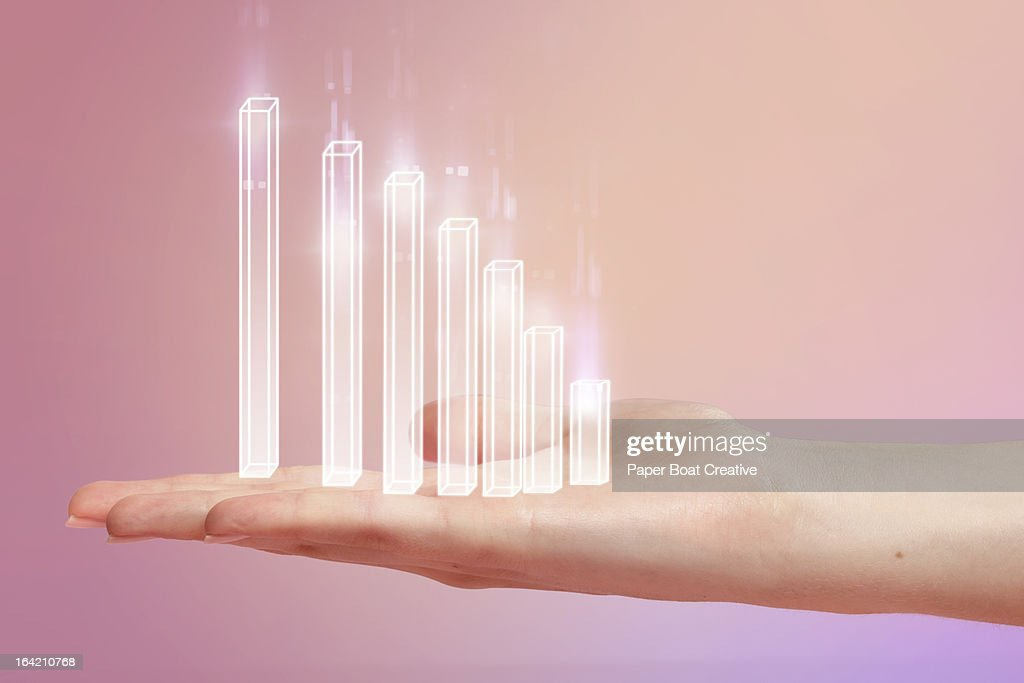Chart resting on hand with pink studio background : Stock Photo