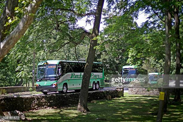 Charter buses for Chelsea Clinton and Marc Mezvinsky's wedding head toward the site of the reception at Astor Courts estates on July 31 2010 in...