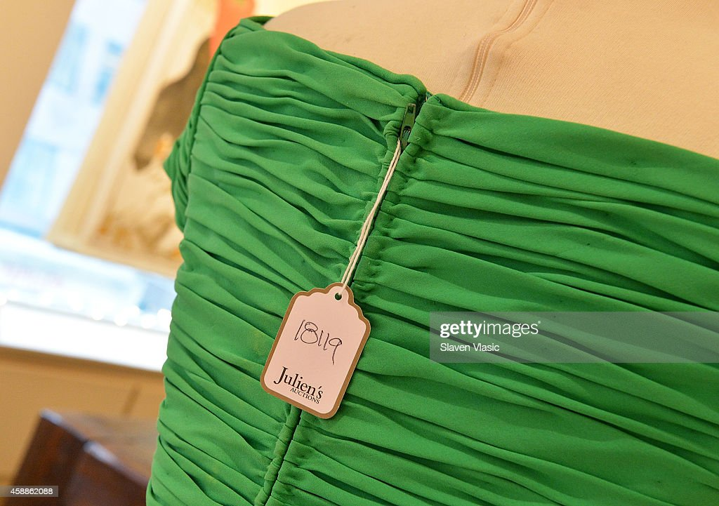 A chartreuse Taroni silk georgette Catherine Walker gown worn by HRH Princess Diana on 11 November 1993 to a banquet at The Dorchester Hotel, to be auctioned by Julien's Auctions of Beverly Hills December 5-6, 2014 on display at Ross Art Gallery on November 12, 2014 in New York City.