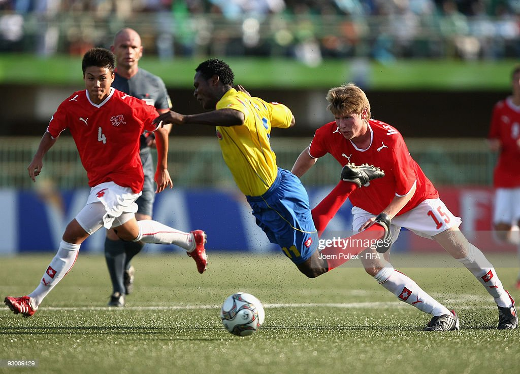 Charyl Chappuis and Sead Hajrovic of Switzerland and Wilson Cuero of Colombia battle for the ball during the FIFA U17 World Cup Semi Final match...