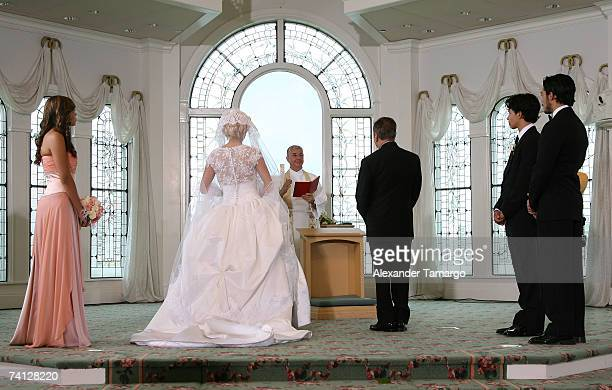 Charytin Goyco and husband Elin Ortiz stand at the altar during Charytin Goyco's dream wedding at Walt Disney World at the Grand Floridian wedding...