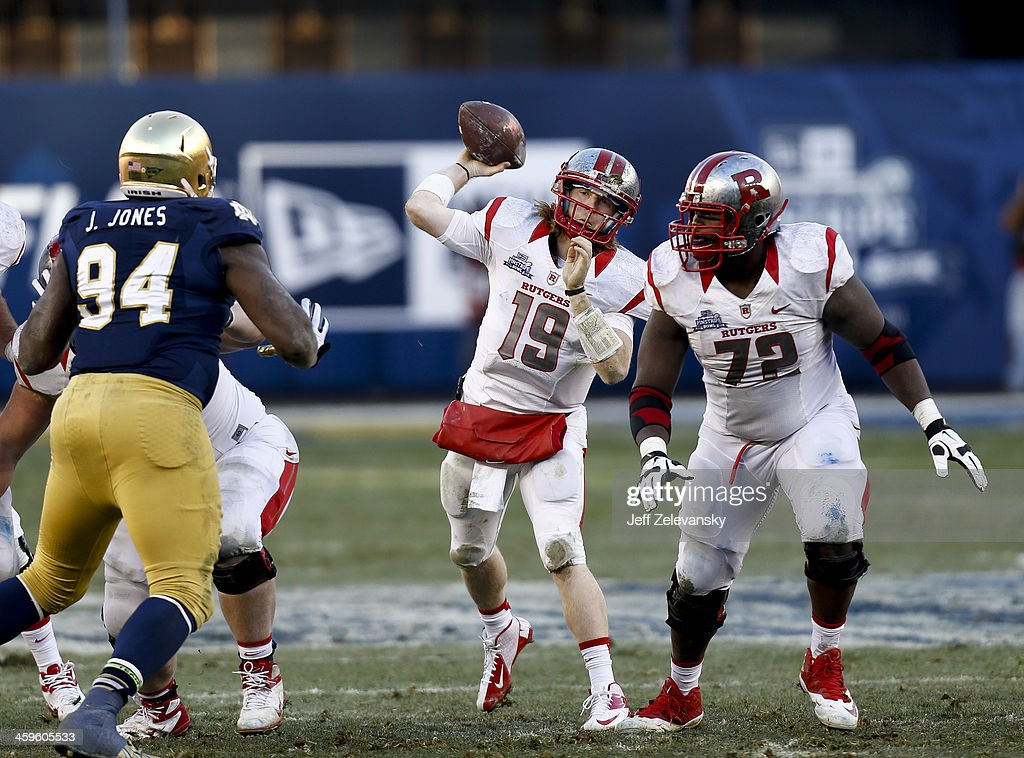 Chas Dodd #19 of the Rutgers Scarlet Knights passes during the New Era Pinstripe Bowl against the Notre Dame Fighting Irish at Yankee Stadium on December 28, 2013 in the Bronx borough of New York City.
