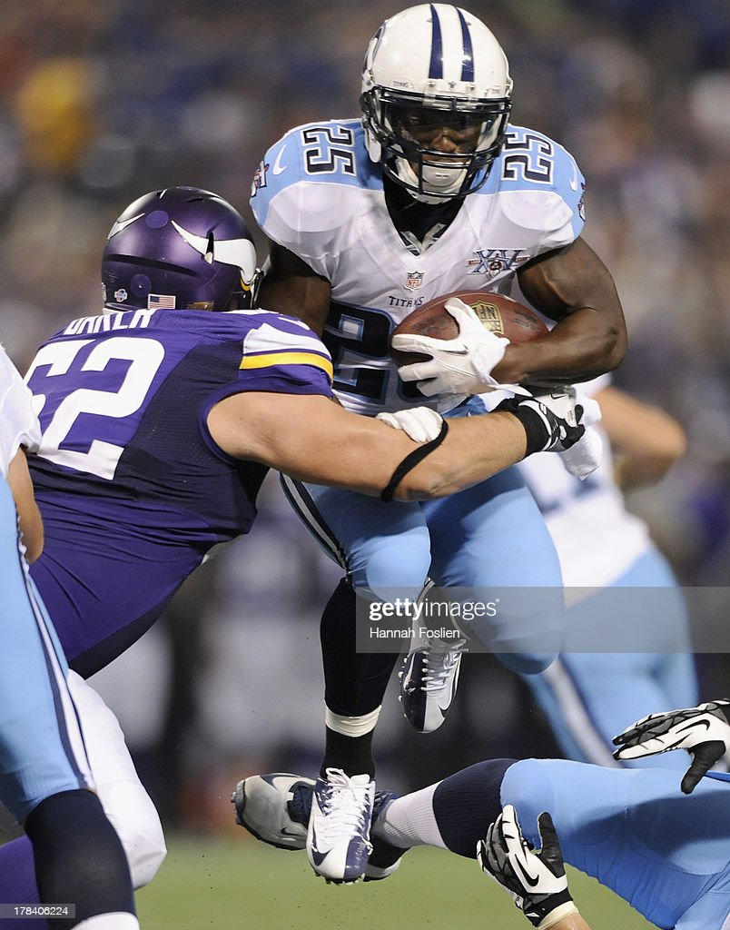 Chase Baker #62 of the Minnesota Vikings tackles <a gi-track='captionPersonalityLinkClicked' href=/galleries/search?phrase=Darius+Reynaud&family=editorial&specificpeople=2108669 ng-click='$event.stopPropagation()'>Darius Reynaud</a> #25 of the Tennessee Titans during the third quarter of the game on August 29, 2013 at Mall of America Field at the Hubert H. Humphrey Metrodome in Minneapolis, Minnesota. The Vikings defeated the Titans 24-23.