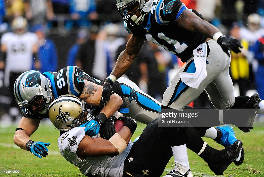 Chase Blackburn and Captain Munnerlyn of the Carolina Panthers tackles Mark Ingram of the New Orleans Saints for a loss during their game at Bank of...