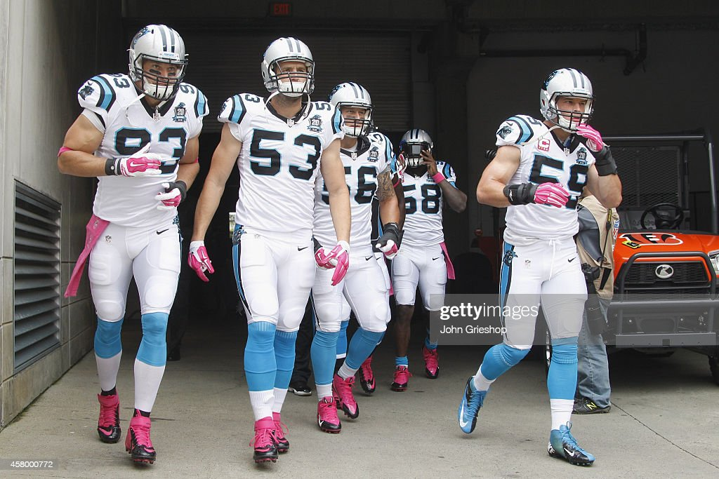 Chase Blackburn Ben Jacobs and Luke Kuechly of the Carolina Panthers take the field for their game against the Cincinnati Bengals at Paul Brown...