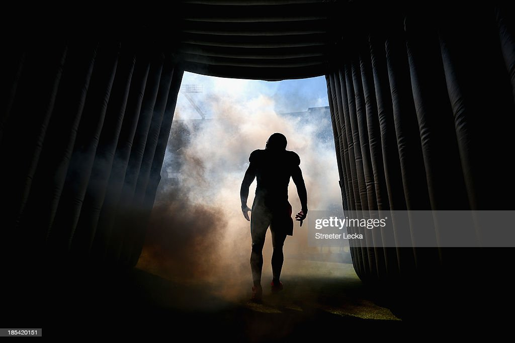 Chase Blackburn of the Carolina Panthers is introduced before their game against the St Louis Rams at Bank of America Stadium on October 20 2013 in...