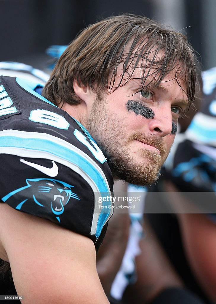 Chase Blackburn of the Carolina Panthers looks on from the bench NFL game action against the Buffalo Bills at Ralph Wilson Stadium on September 15...