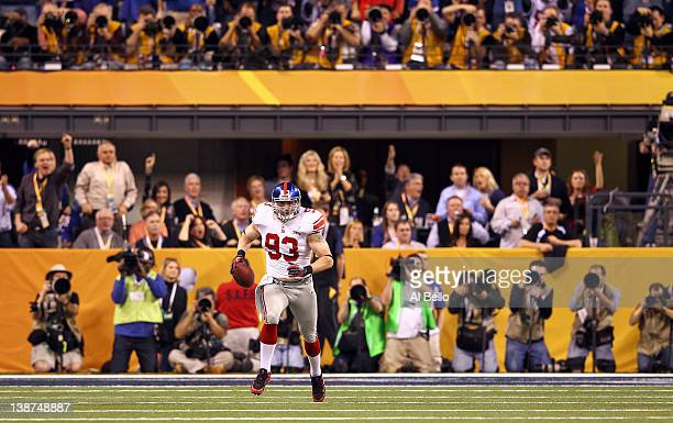 Chase Blackburn of the New York Giants returns an interception for positive yards in the second quarter against the New England Patriots during Super...