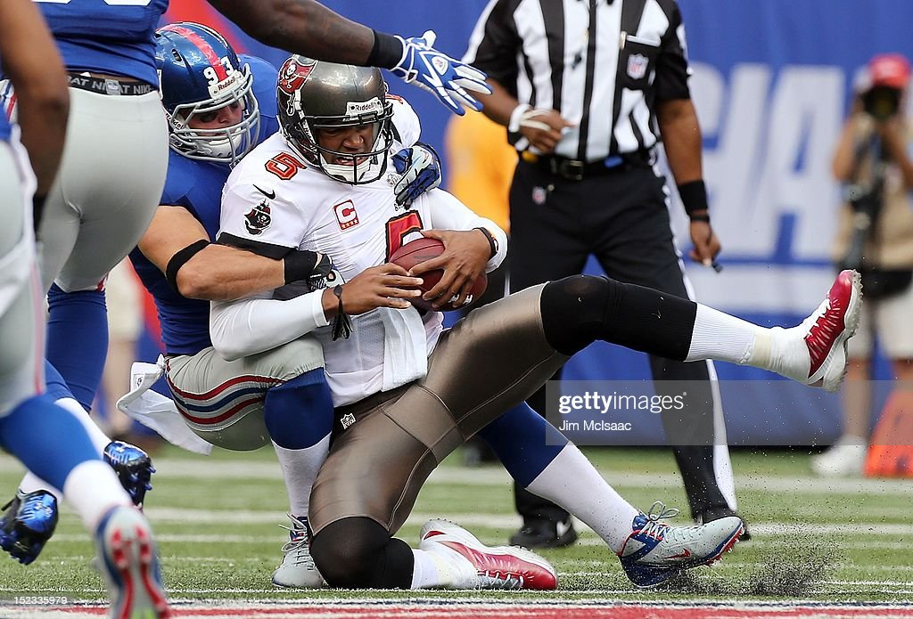 Chase Blackburn of the New York Giants sacks Josh Freeman of the Tampa Bay Buccaneers at MetLife Stadium on September 16 2012 in East Rutherford New...