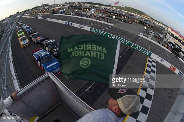 Chase Briscoe driver of the Brad Keselowski's Checkered Flag Foundation Ford F150 and John Hunter Nemechek driver of the Chevrolet Silverado lead the...