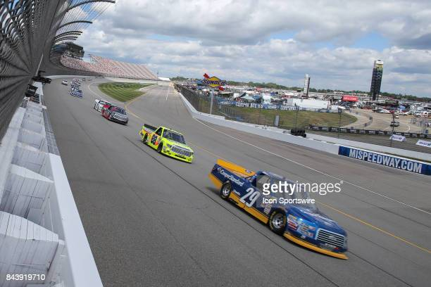 Chase Briscoe driver of the Cooper Standard Ford and Matt Crafton driver of the Ideal Door/Menards Toyota race during the Camping World Truck Series...