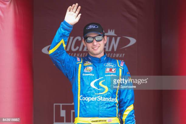 Chase Briscoe driver of the Cooper Standard Ford greets fans during the prerace ceremonies of the Camping World Truck Series LTi Printing 200 race on...