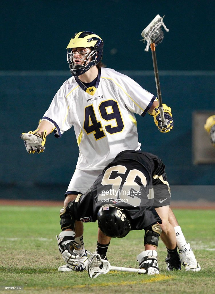Chase Brown #49 of the Michigan Wolverines questions the referee after being called for a foul against Will Mazzone #35 of the Army Black Knights during the 2013 Orange Bowl Lacrosse Classic on March 2, 2013 at SunLife Stadium in Miami Gardens, Florida.