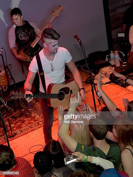 Chase Bryant preforms during CMT After Midnight After Party and Super Bowl Sunday With Big Rich At Dierks Bentley's Whisky Row on February 1 2015 in...
