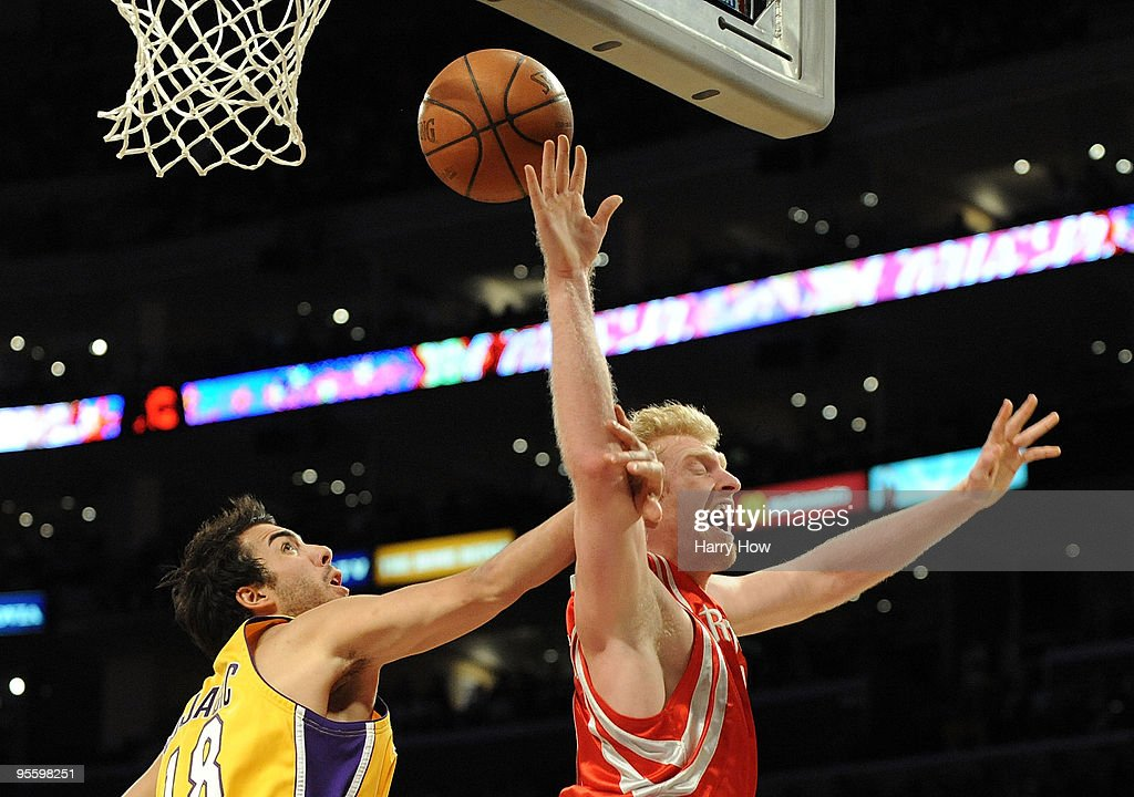 <a gi-track='captionPersonalityLinkClicked' href=/galleries/search?phrase=Chase+Budinger&family=editorial&specificpeople=3847600 ng-click='$event.stopPropagation()'>Chase Budinger</a> #10 of the Houston Rockets is fouled on a layup by <a gi-track='captionPersonalityLinkClicked' href=/galleries/search?phrase=Sasha+Vujacic&family=editorial&specificpeople=210542 ng-click='$event.stopPropagation()'>Sasha Vujacic</a> #18 of the Los Angeles Lakers during the second half at Staples Center on January 5, 2010 in Los Angeles, California.