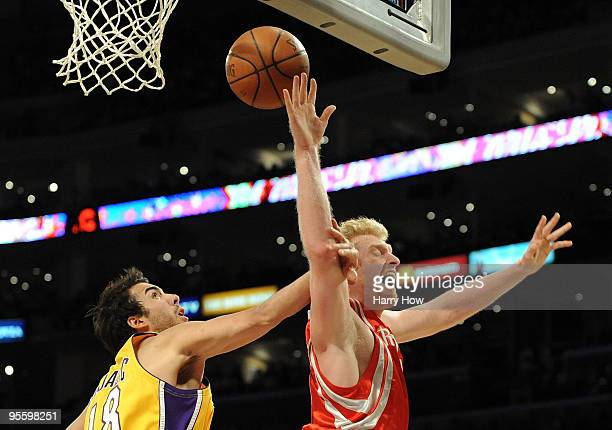 Chase Budinger of the Houston Rockets is fouled on a layup by Sasha Vujacic of the Los Angeles Lakers during the second half at Staples Center on...