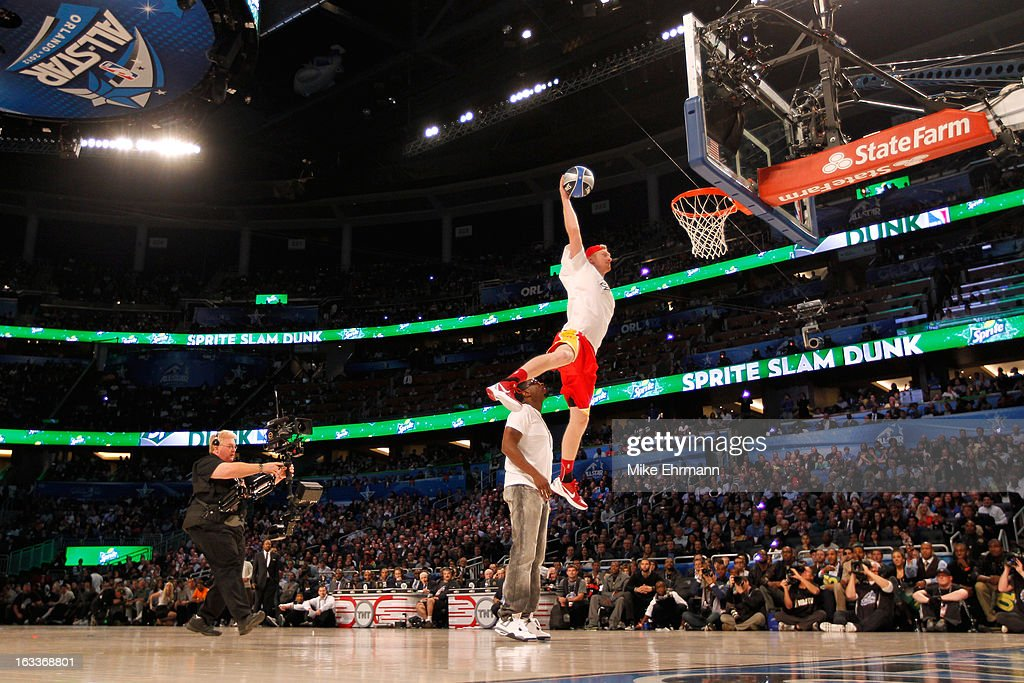 <a gi-track='captionPersonalityLinkClicked' href=/galleries/search?phrase=Chase+Budinger&family=editorial&specificpeople=3847600 ng-click='$event.stopPropagation()'>Chase Budinger</a> of the Houston Rockets jumps over entertainer Sean 'P.Diddy' Combs during the Sprite Slam Dunk Contest part of 2012 NBA All-Star Weekend at Amway Center on February 25, 2012 in Orlando, Florida.
