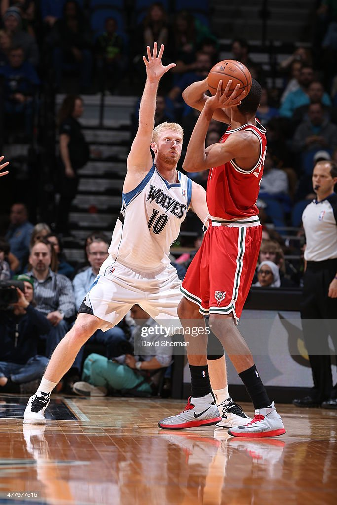 Chase Budinger #10 of the Minnesota Timberwolves defends against the Milwaukee Bucks on March 11, 2014 at Target Center in Minneapolis, Minnesota.