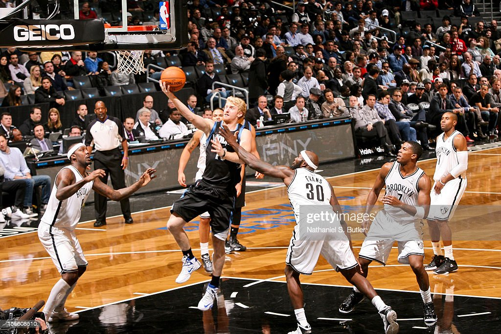 Chase Budinger #10 of the Minnesota Timberwolves goes to the basket against Reggie Evans #30 of the Brooklyn Nets on November 5, 2012 at the Barclays Center in Brooklyn, New York.