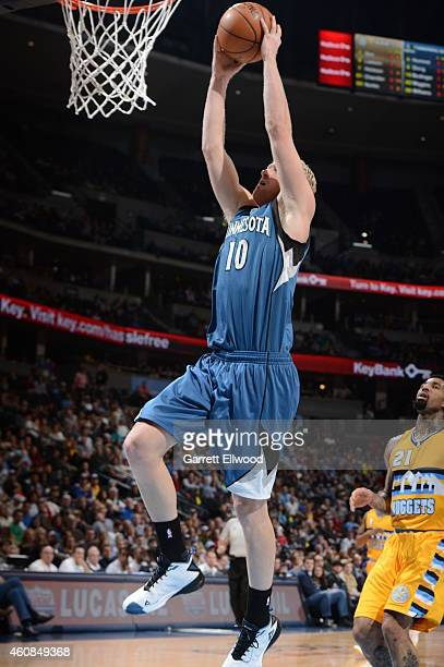 Chase Budinger of the Minnesota Timberwolves goes to the basket against the Denver Nuggets on December 26 2014 at the Pepsi Center in Denver Colorado...
