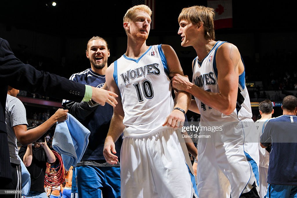 Chase Budinger #10 of the Minnesota Timberwolves is congratulated by teammates Andrei Kirilenko #47 and Lou Amundson #17 after scoring the winning basket against the Indiana Pacers on November 9, 2012 at Target Center in Minneapolis, Minnesota.
