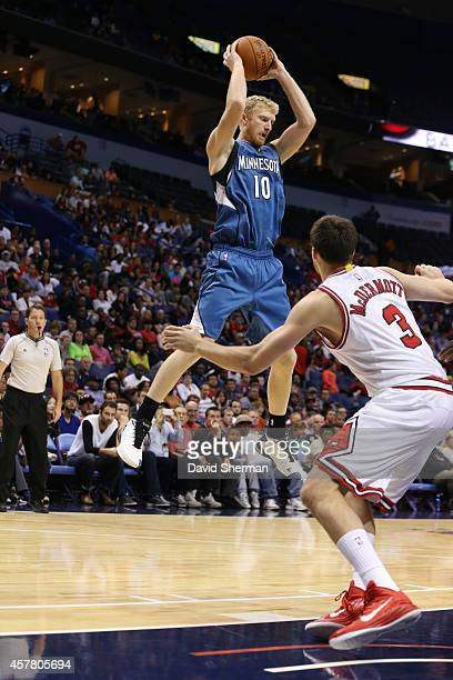 Chase Budinger of the Minnesota Timberwolves jumps for the ball against Doug McDermott of the Chicago Bulls during the game on October 24 2014 at...