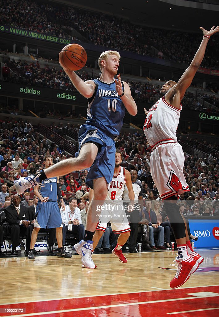 Chase Budinger #10 of the Minnesota Timberwolves looks to pass over Taj Gibson #22 of the Chicago Bulls on November 10, 2012 at the United Center in Chicago, Illinois.