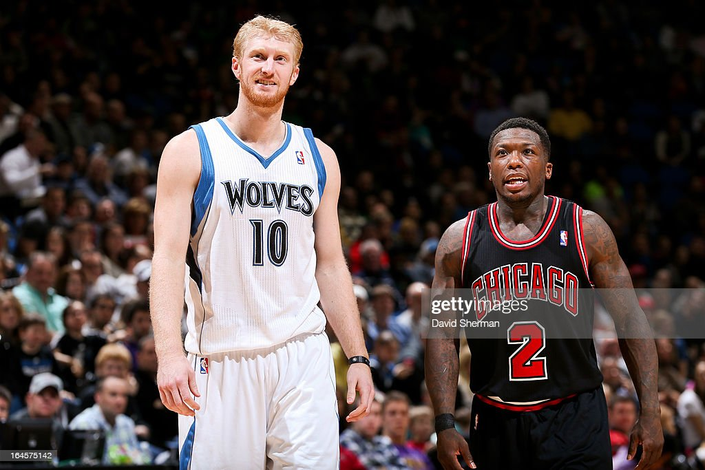Chase Budinger #10 of the Minnesota Timberwolves shares a laugh with Nate Robinson #2 of the Chicago Bulls before resuming action in their game on March 24, 2013 at Target Center in Minneapolis, Minnesota.