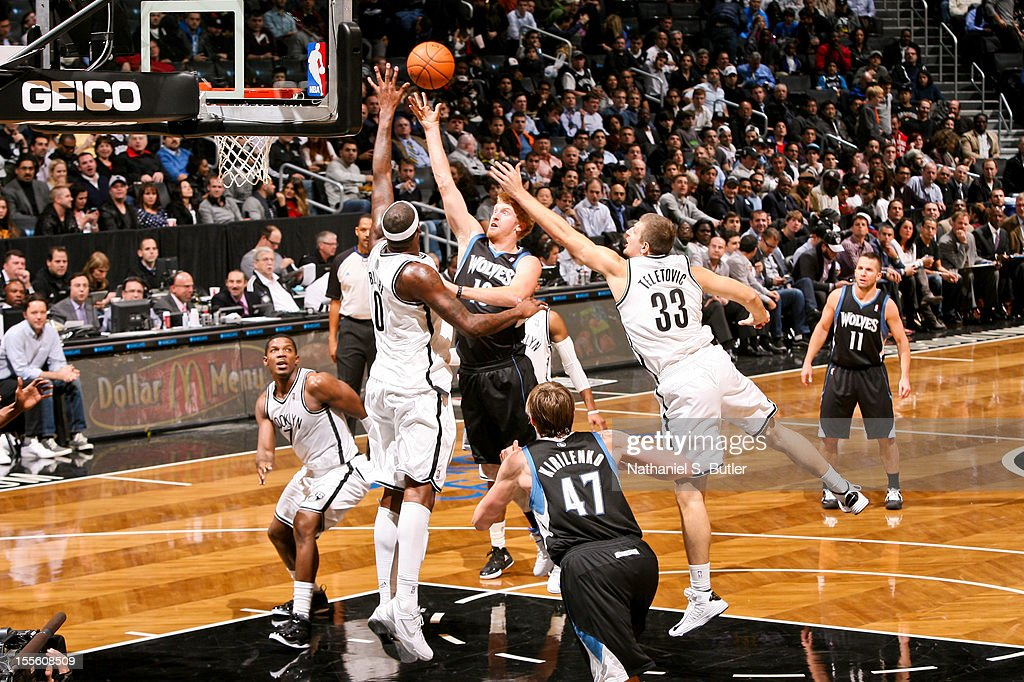 Chase Budinger #10 of the Minnesota Timberwolves shoots against Andray Blatche #0 of the Brooklyn Nets on November 5, 2012 at the Barclays Center in Brooklyn, New York.